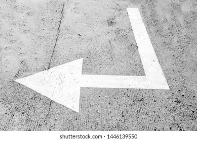 Road sign indicating White arrow sign on the street, Direction for traffic safety . white arrows pointing directions on gray asphalt floor. Your can Walking direction way . Symbol of crossroads