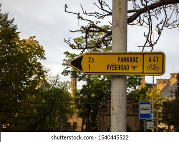A road sign informing that one kilometer can be reached Vysehrad, and two and a half kilometers to Pankrac. Prague, Czech Republic - October 2019