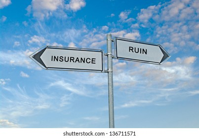 Road sign to insurance and ruin