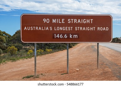 Road sign at the longest straight road in Australia.