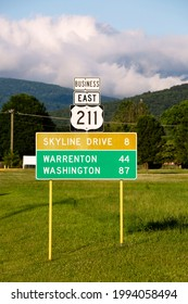 Road sign in Luray Virginia with beautiful mountains in the background
