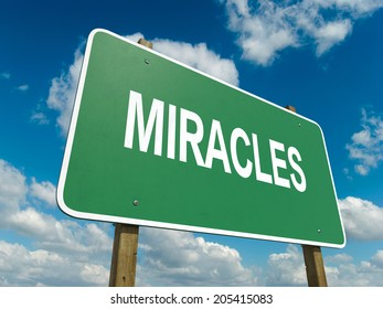 A road sign with miracles words on sky background