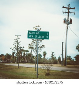 Road sign to New Orleans, street pole, vintage