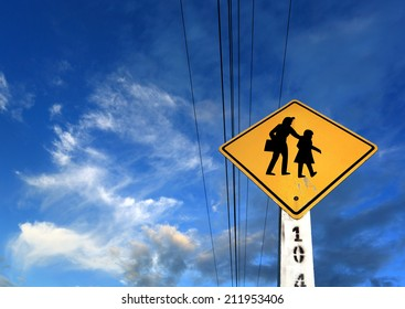 Road sign on blue sky background