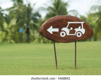 """""""Road sign"""" on a golf course, instructing carts to turn left before the green"""