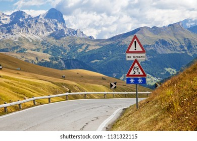 Road sign on a mountain road in Dolomites