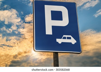road sign Parking area or Rest stop against the evening sky