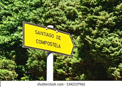 Road sign pointing to the city Santiago de Compostela. The Way of Saint James (El Camino de Santiago).