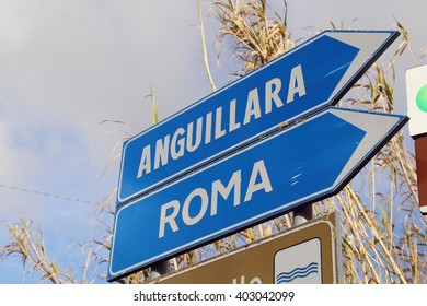 Road sign pointing to Rome, Italy