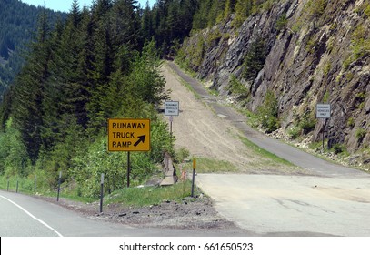 Road Sign for Runaway truck ramp in the forest on a mountain road, designed to slow down a vehicle and help prevent accidents if a commercial truck loses braking or loses control down a steep hill.