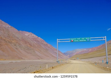 Road sign showing the Agua Negra Tunnel project through the Agua Negra Mountain Pass from La Rioja, Argentina to the Elqui Valley, Chile, South America. Sign on the Argentine side.