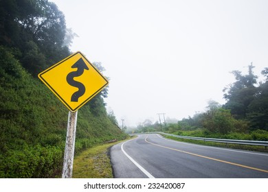 road sign showing curves ahead