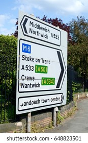 A road sign showing direction to towns in Cheshire