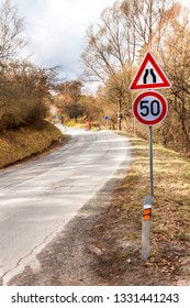 Road sign speed limit on the road in Czech Republic. Dangerous place on the road.  Asphalt road in the countryside.