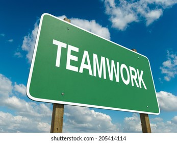 A road sign with teamwork words on sky background
