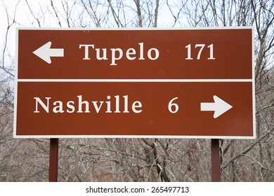 Road sign to Tupelo and Nashville on the Natchez Trace Parkway arched bridge, outside of Nashville, Tenn., USA