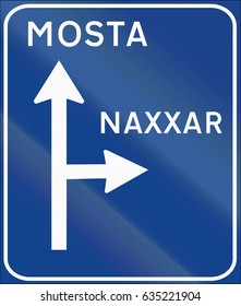 Road sign used in Malta - Direction sign.