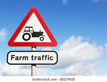 Road sign warning of farm traffic on the road ahead.