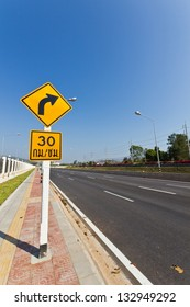 Road Sign warns Drivers to Limit Speed Ahead Dangerous Curve.