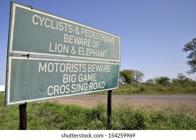 A road sign warns pedestrians and cyclists to beware of lions and elephants on a road in Swaziland, Africa.