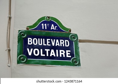 road sign with written Boulevard Voltaire in French in Paris