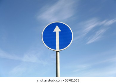 Road signs against a blue sky