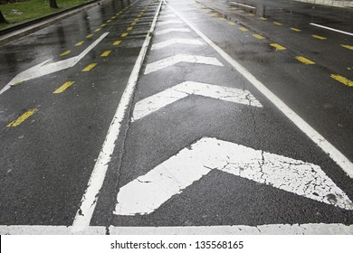 Road Signs with arrows wet conditions and transport regulations