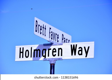 Road signs for Bret Favre Pass and Holmgren Way in Green Bay Wisconsin.