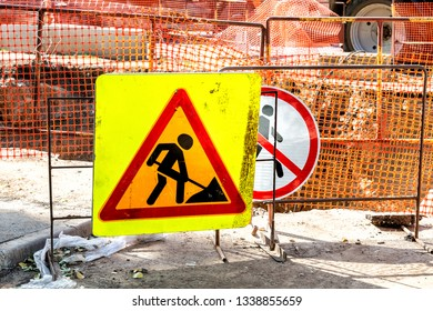 Road signs at the construction site in summer day