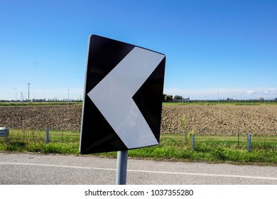 road signs indicating direction on curved road