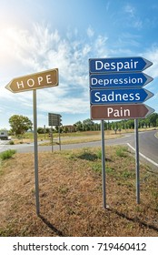 "Road signs with the inscription ""Hope"", ""Sadness"", ""Pain"", ""Depression"", ""Despair"""