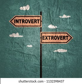 Road signs with Introvert and Extrovert text pointing in opposite directions