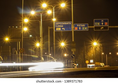 Road signs to Lappeenranta and St. Petersburg. Night track in Finland. Long exposure