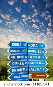 Road signs pointing different directions in Tuscany, Italy