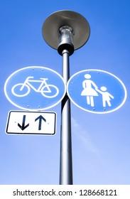 road signs at a sidewalk