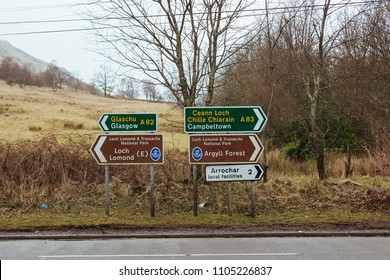 Road signs in Tarbet village towards A82 and A83, as well as the local recreational attractions, Scotland, UK