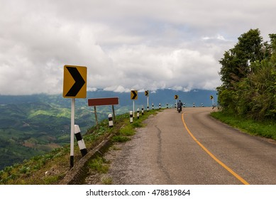 Road sing in rural area with mountain background