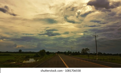 The road with the sky and black cloud
