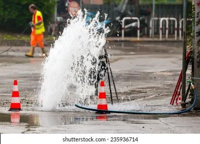 road spurt water beside traffic cones