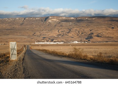 The road and the steppe at dawn , the Caucasus.