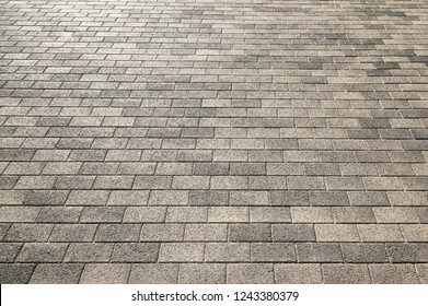 Road stone grey pavement texture background close up