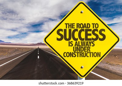 The Road to Success is Always Under Construction sign on desert road