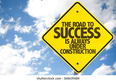 The Road to Success is Always Under Construction sign with sky background