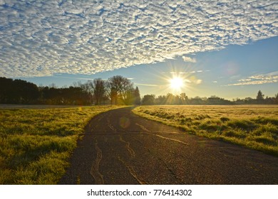 Road at sunrise with clouds