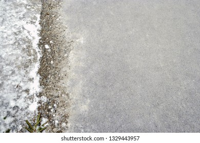 Road surface with line of snow or frozen water