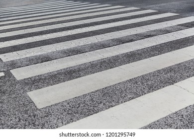 road surface marking and traffic concept - close up of crosswalk