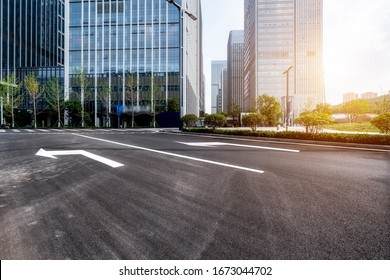 Road surface and urban building skyline