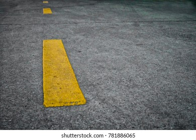 Road surface with yellow dashed parallel to the road. The line of the car.Channel of driving.Traffic sign