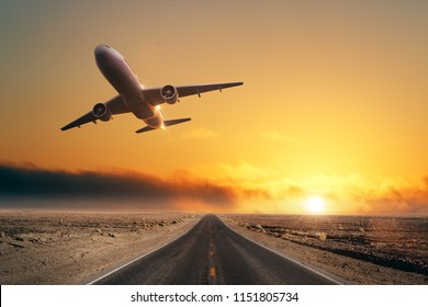 Road with taking off airplane. Travel and takeoff concept