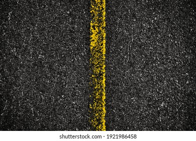Road texture, a top view of a yellow distressed line on the road